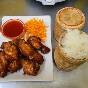 Chicken wings served with rice and carrot with sweet chilli sauce