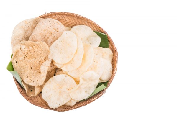 Freshy fried delicious prawn and fish crackers on rattan tray