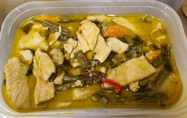 thai green curry in takeaway container with veg