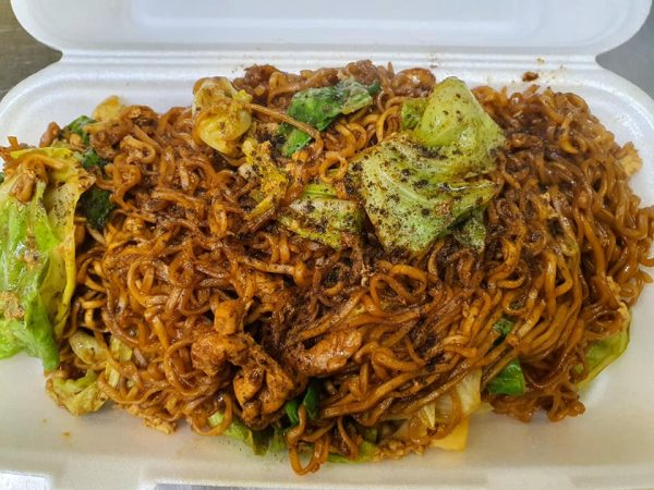 pad mama noodles in peppercorn sauice with thin noodles chicken and cabbage