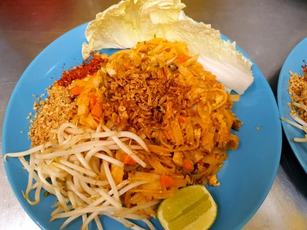 pad thai with cucumber and prawn crackers bamboo shoots and peanuts