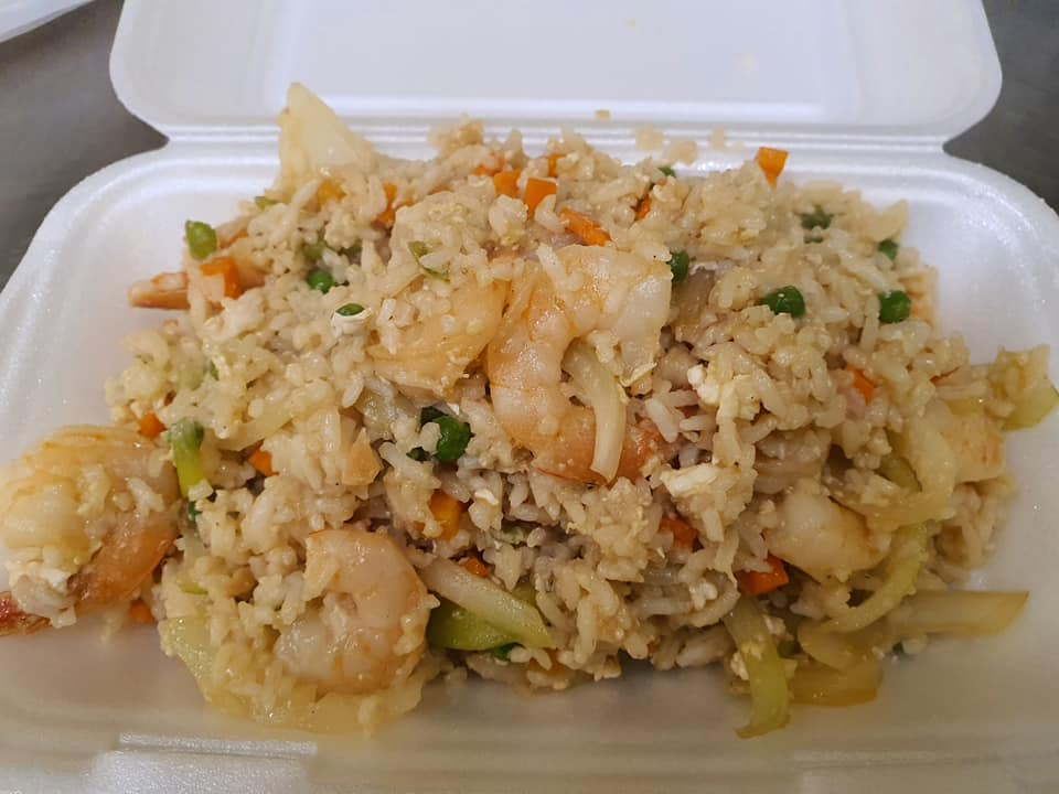 thai prawn fried rice with spring oninos, eggs and thai flavours