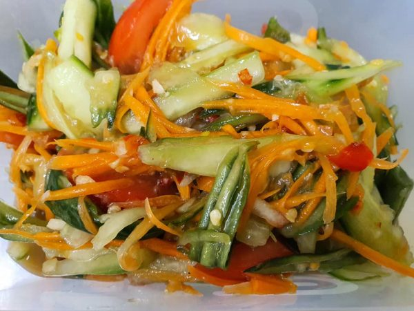 size salad with cucumber tomatoes carrots and dressing
