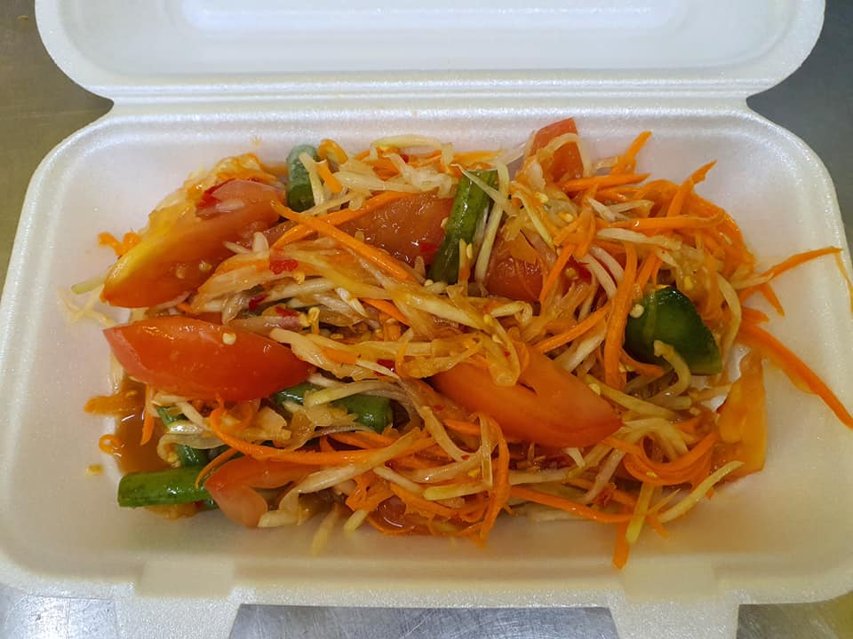 fresh vegetable salad with carrots, tomatoes, cucumber, and dressing